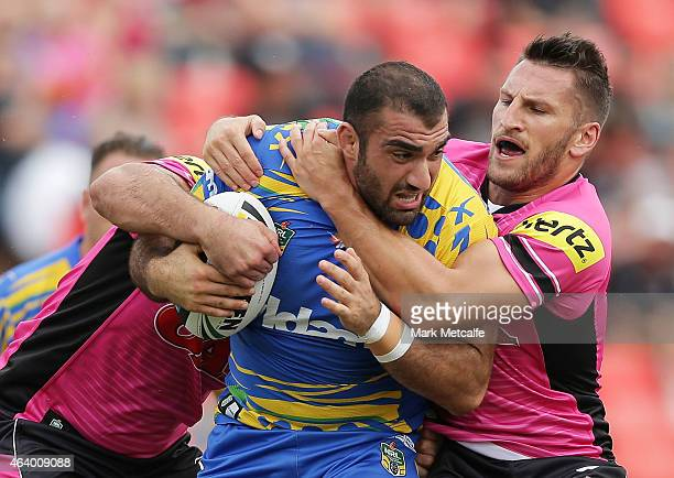 Tim Mannah of the Eels is tackled by Lewis Brown of the Panthers during the NRL Trial Match between the Penrith Panthers and the Parramatta Eels at...