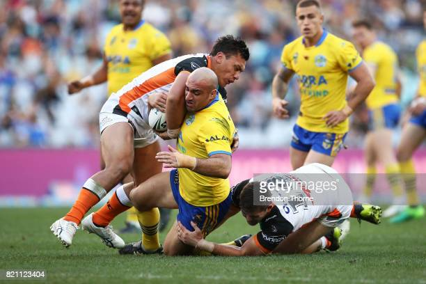 Tim Mannah of the Eels is tackled by the Tigers defence during the round 20 NRL match between the Wests Tigers and the Parramatta Eels at ANZ Stadium...