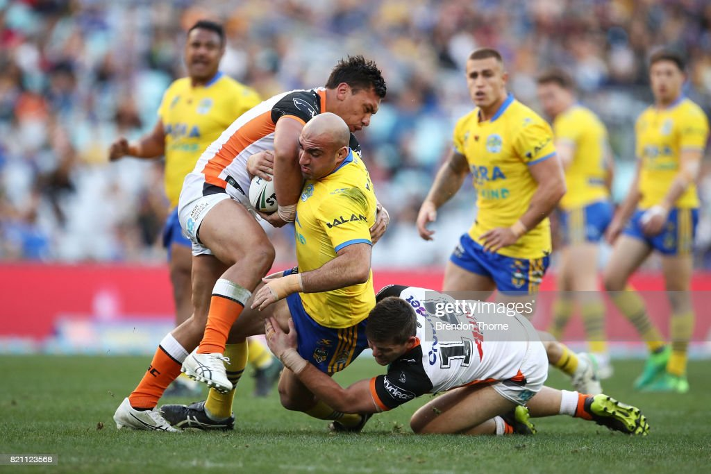 Tim Mannah of the Eels is tackled by the Tigers defence during the round 20 NRL match between the Wests Tigers and the Parramatta Eels at ANZ Stadium on July 23, 2017 in Sydney, Australia.