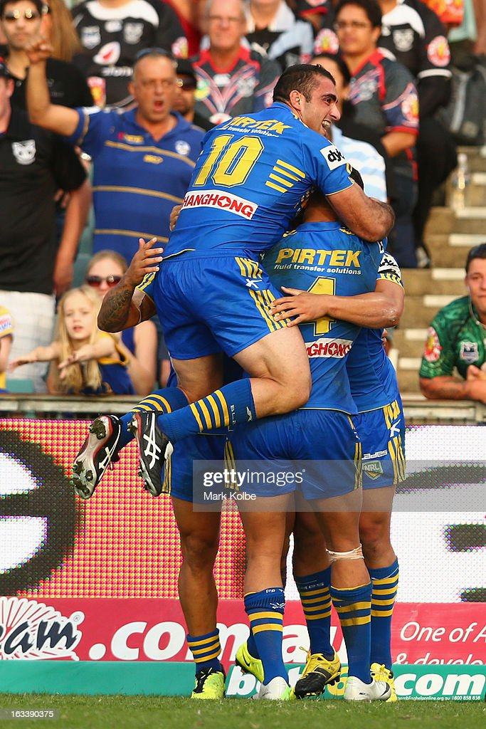 Tim Mannah of the Eels jumps on Ken Sio of the Eels as he celebrates with his team mates after scoring a try during the round one NRL match between the Parramatta Eels and the Warriors at Parramatta Stadium on March 9, 2013 in Sydney, Australia.