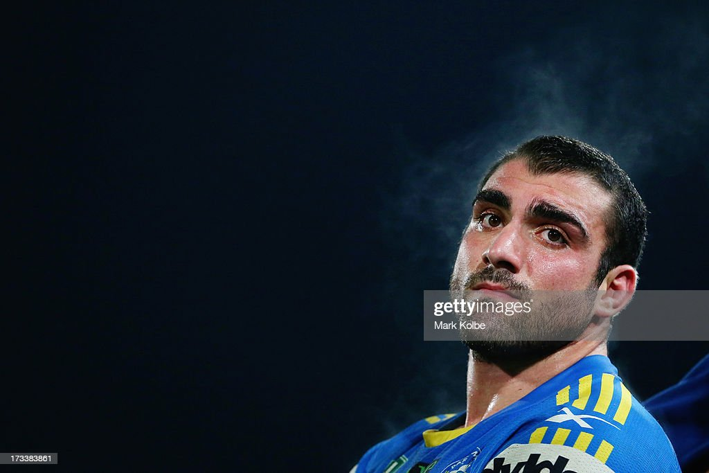 Tim Mannah of the Eels looks dejected as he watches on from the sideline during the round 18 NRL match between Parramatta Eels and the Penrith Panthers at Parramatta Stadium on July 13, 2013 in Sydney, Australia.