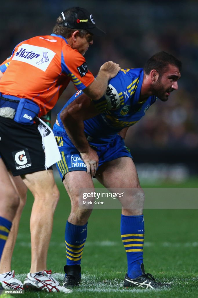 Tim Mannah of the Eels receives attention from the trainer during the round nine NRL match between the Parramatta Eels and the Brisbane Broncos at Parramatta Stadium on May 11, 2013 in Sydney, Australia.