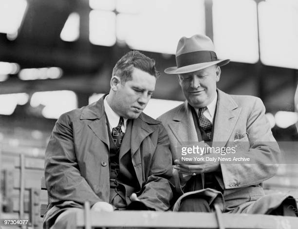 Tim Mara owner of grid New York Giants checks over race card with plunger Art Rooney owner of grid Pittsburgh Pirates at Ebbets Field Meanwhile Art's...