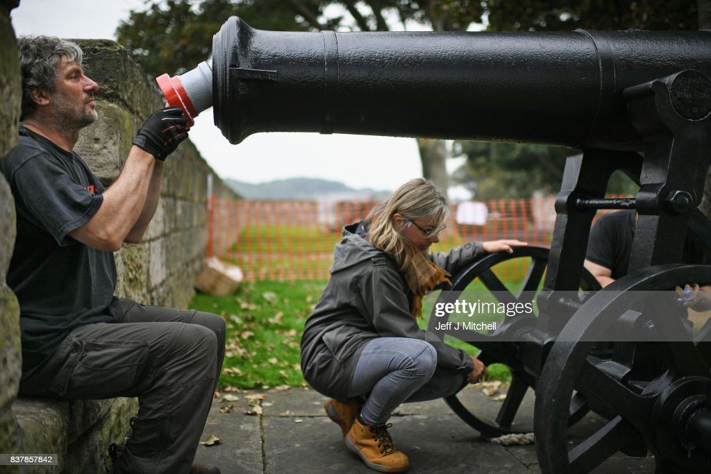 Tim Martin and Leesa Vere Stevens place a restored canon captured at Sebastapol in 1856 onto the town walls on August 23, 2017 in Berwick-upon-Tweed, England.English Heritage's only Russian cannon, made in 1826, returns to Berwick after extensive restorative works. Gifted to the town of Berwick in 1858 as a trophy of the Crimean War, it has since been preserved as a key historical artefact. The recent conservation works will protect the cannon from harsh coastal weather conditions, keeping it preserved for future generations and continuing its long tradition of care.