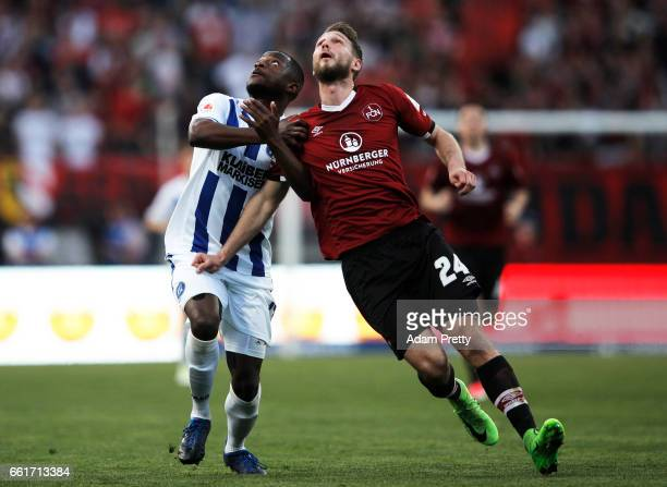 Tim Matavz of 1FC Nuernberg is challenged by David Kinsombi of Karlsruher SC during the Second Bundesliga match between 1 FC Nuernberg and Karlsruher...