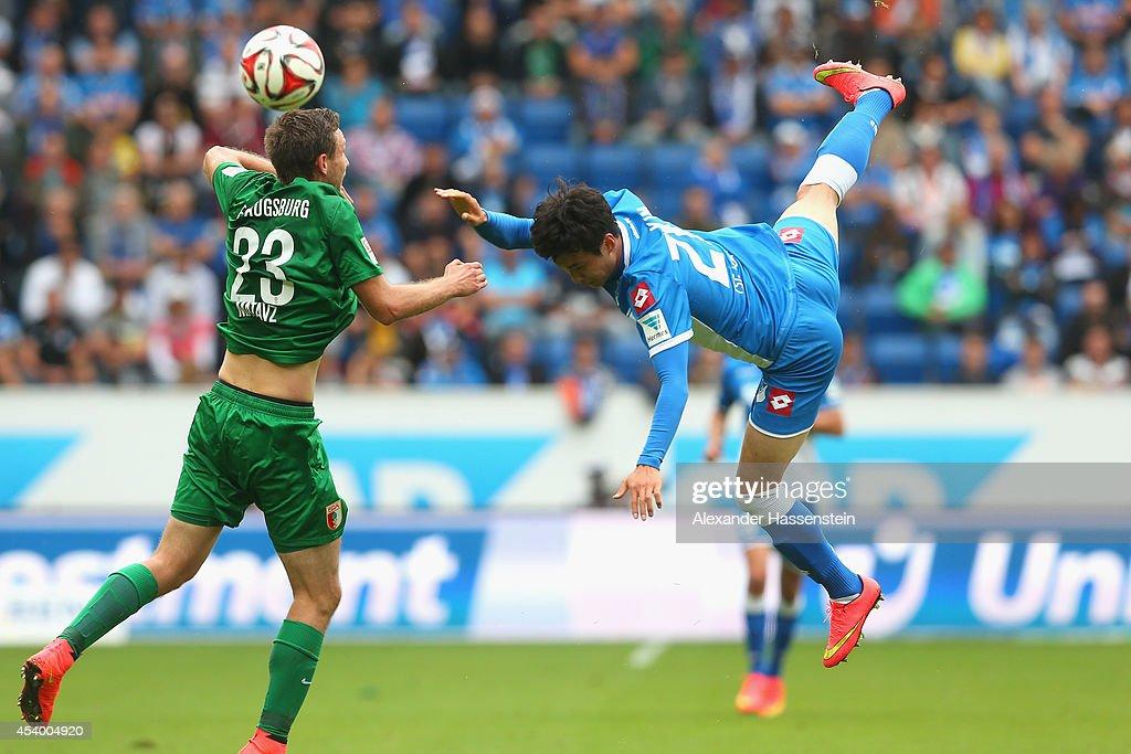 Tim Matavz(L) of Augsburg battles for the ball with Jin-Su Kim of Hoffenheim during the Bundesliga match between TSV 1899 Hoffenheim and FC Augsburg at Wirsol Rhein-Neckar-Arena on August 23, 2014 in Sinsheim, Germany.