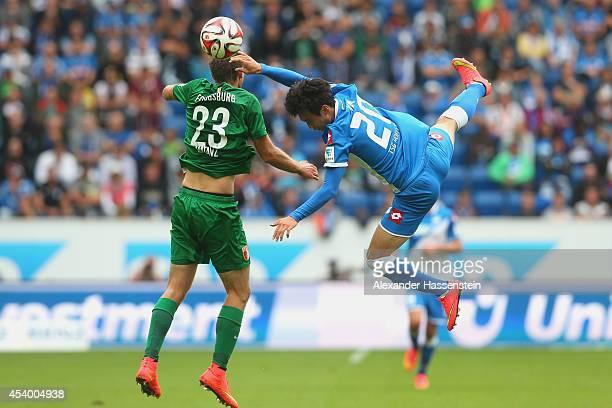 Tim Matavz of Augsburg battles for the ball with JinSu Kim of Hoffenheim during the Bundesliga match between TSV 1899 Hoffenheim and FC Augsburg at...