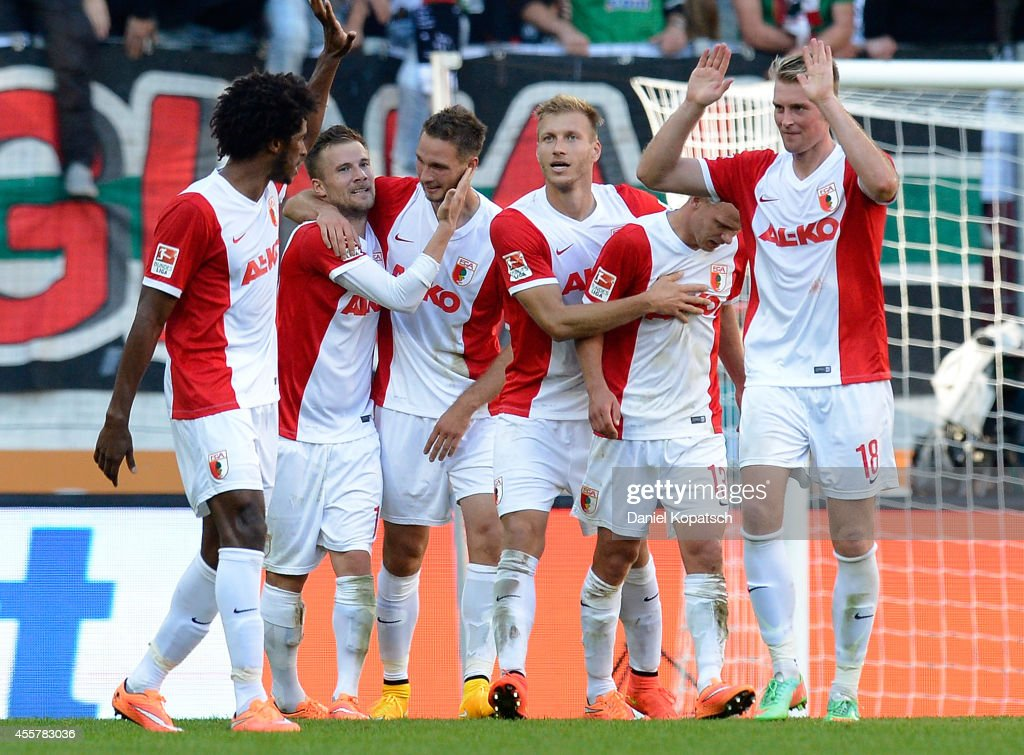 Tim Matavz of Augsburg (C) celebrates his team's fourth goal with team mates during the Bundesliga match between FC Augsburg and SV Werder Bremen at SGL Arena on September 20, 2014 in Augsburg, Germany.