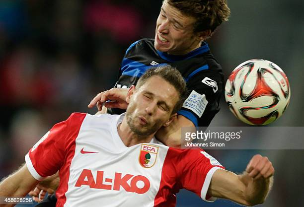 Tim Matavz of Augsburg competes for the ball with Patrick Ziegler of Paderborn during the Bundesliga match between FC Augsburg and SC Paderborn 07 at...