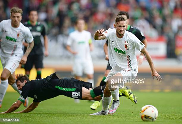 Tim Matavz of Augsburg wins the competition for the ball against Christian Schulz of Hannover during the Bundesliga match between FC Augsburg and...