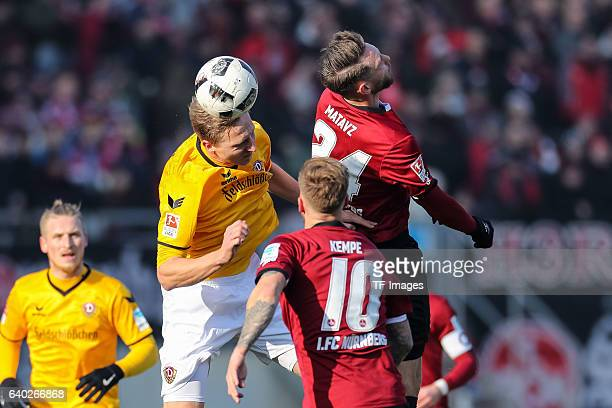 Tim Matavz of FC Nuernberg Tobias Kempe of FC Nuernberg and Marco Hartmann of Dynamo Dresden battle for the ball during the Second Bundesliga match...