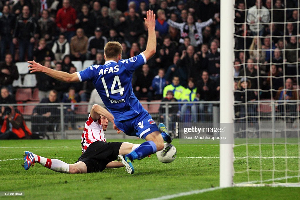 Tim Matavz of PSV shoots and scores with the final touch of the game to win the Eredivisie match between PSV Eindhoven and AZ Alkmaar at Philips...