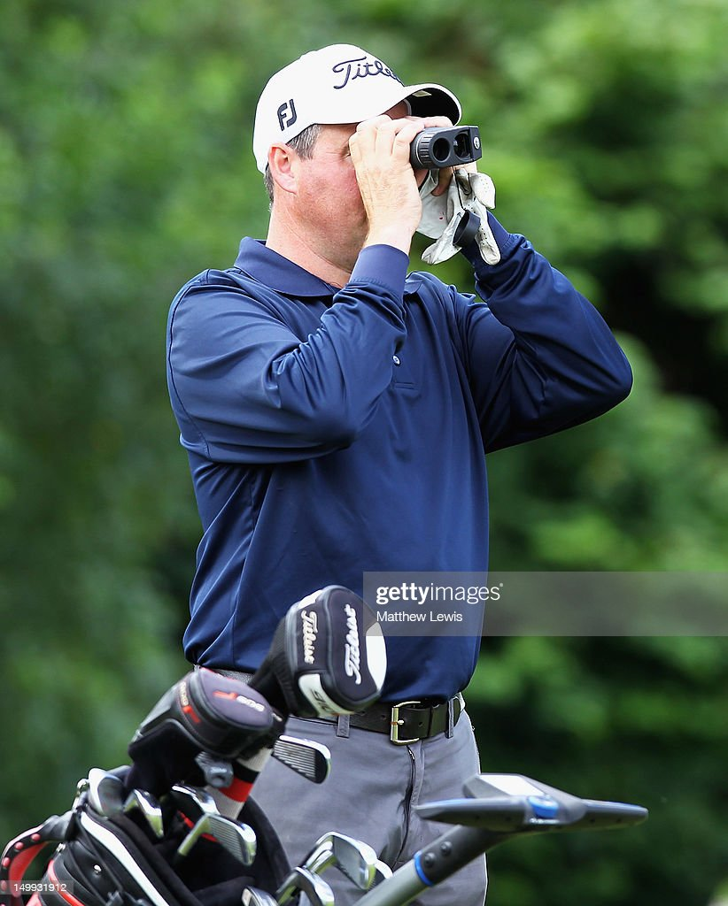 Tim Maxwell of Knutsford Golf Club measures the distance to the pin during day one of the Glenmuir PGA Professional Championship at Carden Park Golf Club on August 7, 2012 in Chester, England.