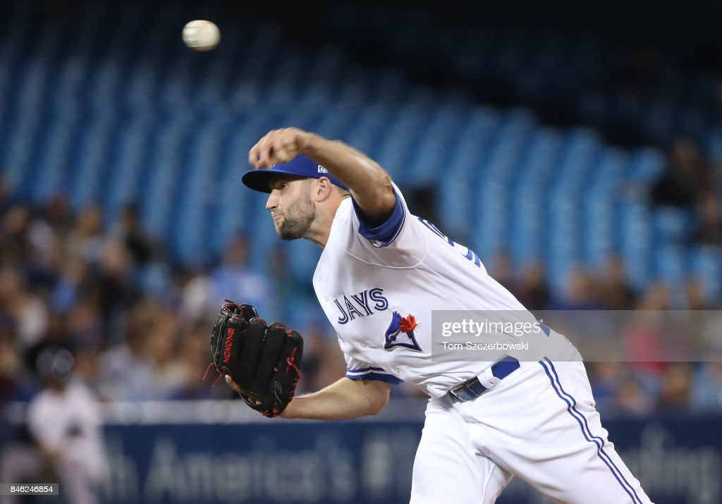 Tim Mayza #58 of the Toronto Blue Jays delivers a pitch in the ninth inning during MLB game action against the Baltimore Orioles at Rogers Centre on September 12, 2017 in Toronto, Canada.