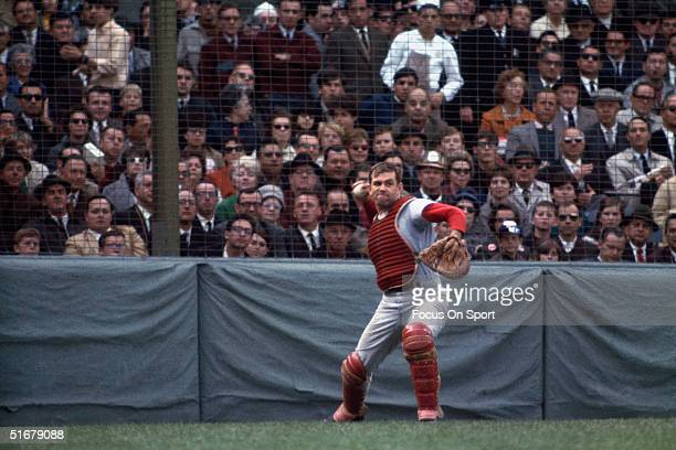 Tim McCarver catcher for the St Louis Cardinals throws back to the field playing against the Boston Red Sox during the World Series at Fenway Park on...