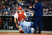 Tim McCarver of the Philadelphia Phillies tags the sliding Dave Cash of the Montreal Expos during an Major League Baseball game circa 1979 at...