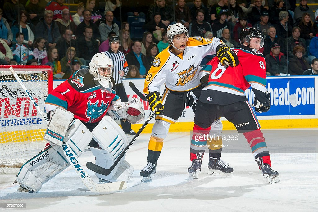 Tim McGauley #23 of Brandon Wheat Kings looks for the pass between Jackson Whistle #1 and Colten Martin #8 of Kelowna Rockets during the second period on October 25, 2014 at Prospera Place in Kelowna, British Columbia, Canada.