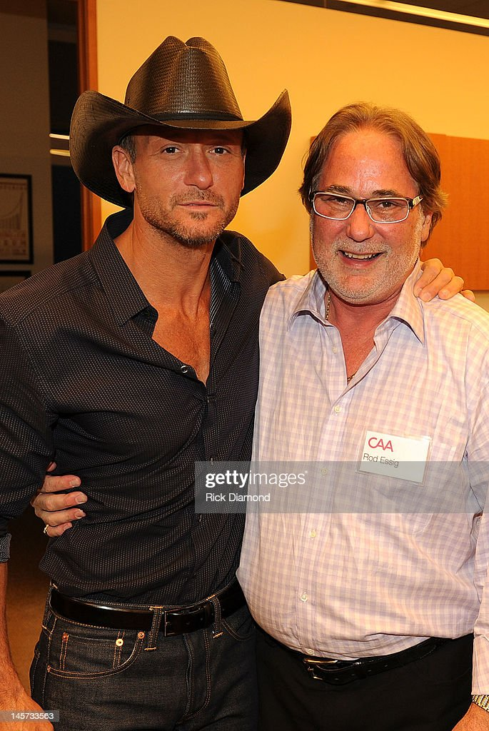 <a gi-track='captionPersonalityLinkClicked' href=/galleries/search?phrase=Tim+McGraw&family=editorial&specificpeople=202845 ng-click='$event.stopPropagation()'>Tim McGraw</a> and CAA's Rod Essig celebrate the new CAA Nashville offices at the 20th Annual CAA BBQ on June 4, 2012 in Nashville, Tennessee.