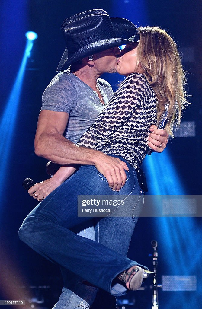Tim McGraw and Faith Hill kiss onstage at the 2014 CMA Festival on June 5 2014 in Nashville Tennessee