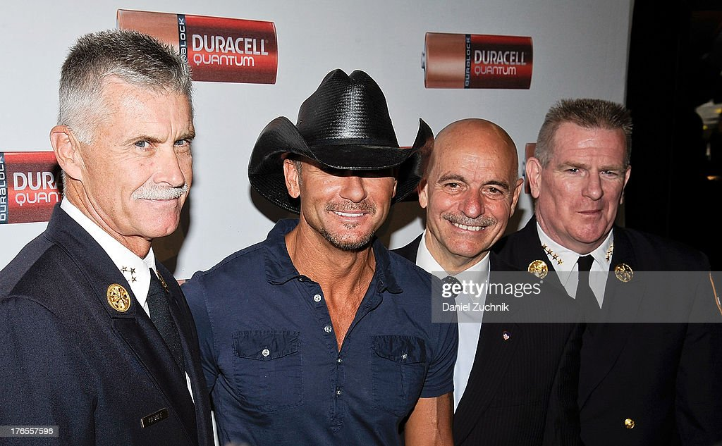 <a gi-track='captionPersonalityLinkClicked' href=/galleries/search?phrase=Tim+McGraw&family=editorial&specificpeople=202845 ng-click='$event.stopPropagation()'>Tim McGraw</a> and New York Fire Commissioner Salvatore Cassano (2nd R) attend the 'Quantum Heroes' premiere at Engine 33, Ladder 9 on August 15, 2013 in New York City.