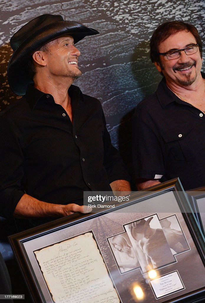 <a gi-track='captionPersonalityLinkClicked' href=/galleries/search?phrase=Tim+McGraw&family=editorial&specificpeople=202845 ng-click='$event.stopPropagation()'>Tim McGraw</a> and producer Byron Gallimore Celebrate <a gi-track='captionPersonalityLinkClicked' href=/galleries/search?phrase=Tim+McGraw&family=editorial&specificpeople=202845 ng-click='$event.stopPropagation()'>Tim McGraw</a>'s Multi-Week No. 1 'Highway Don't Care' at Music City Tippler on August 20, 2013 in Nashville City.