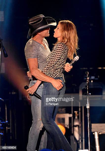Tim McGraw and wife Faith Hill perform onstage during the 2014 CMA Festival at LP Field on June 5 2014 in Nashville Tennessee