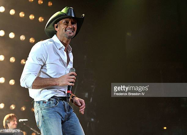 Tim McGraw performs during Keith Urban's Fourth annual We're All For The Hall benefit concert at Bridgestone Arena on April 16 2013 in Nashville...