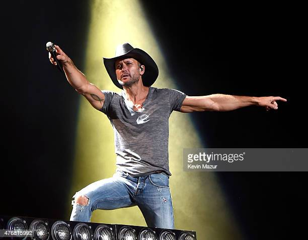 Tim McGraw performs onstage during his 'Shotgun Rider' tour at Nikon at Jones Beach Theater on June 11 2015 in Wantagh New York