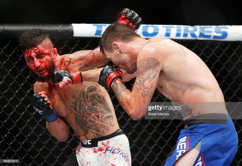 Tim Means hits Sabah Homasi during their welterweight bout at the UFC 202 event at TMobile Arena on August 20 2016 in Las Vegas Nevada Means won by...