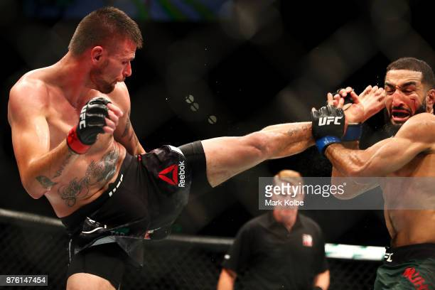 Tim Means of the USA kicks Belal Muhammad of the USA in their welterweight bout during the UFC Fight Night at Qudos Bank Arena on November 19 2017 in...