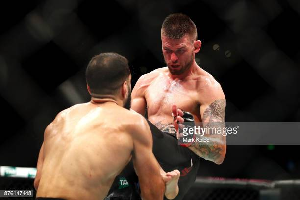 Tim Means of the USA knees Belal Muhammad of the USA in their welterweight bout during the UFC Fight Night at Qudos Bank Arena on November 19 2017 in...
