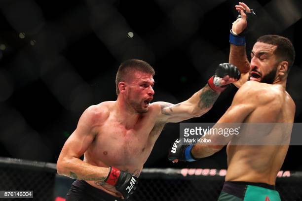 Tim Means of the USA punches Belal Muhammad of the USA in their welterweight bout during the UFC Fight Night at Qudos Bank Arena on November 19 2017...