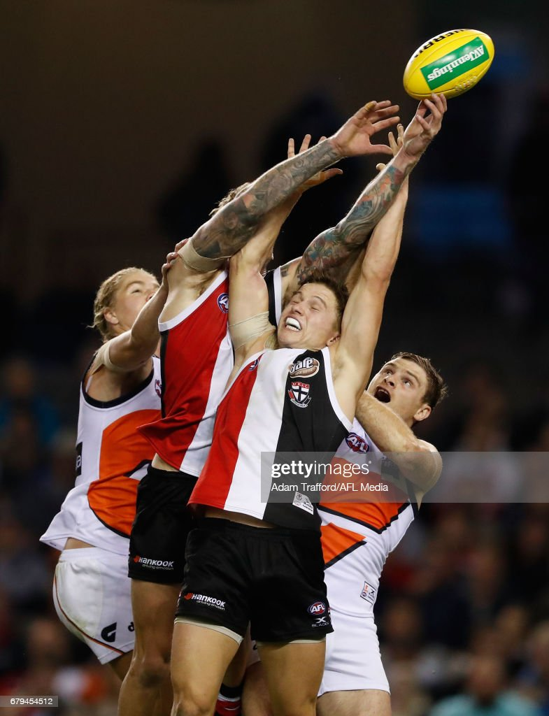 Tim Membrey (left) and Jack Billings of the Saints compete for the ball with Harrison Himmelberg (left) and Heath Shaw of the Giants during the 2017 AFL round 07 match between the St Kilda Saints and the GWS Giants at Etihad Stadium on May 05, 2017 in Melbourne, Australia.