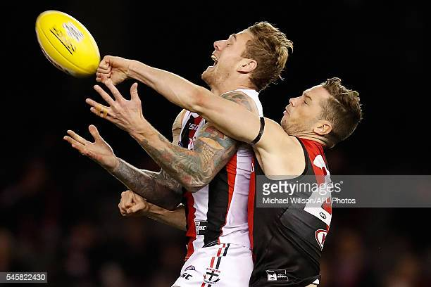 Tim Membrey of the Saints and Patrick Ambrose of the Bombers compete for the ball during the 2016 AFL Round 16 match between the Essendon Bombers and...