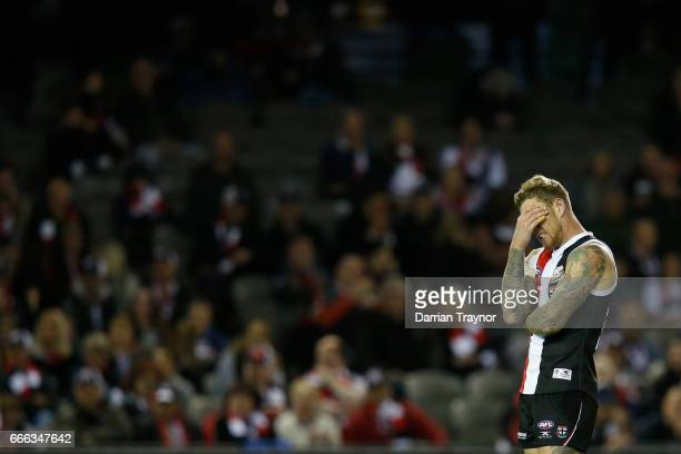 Tim Membrey of the Saints covers his face after missing an easy goal during the round three AFL match between the St Kilda Saints and the Brisbane...