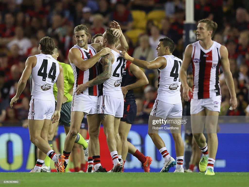 Tim Membrey of the Saints is congratulated by team mates after kicking a goal during the round six AFL match between the Melbourne Demons and the St Kilda Saints at Etihad Stadium on April 30, 2016 in Melbourne, Australia.