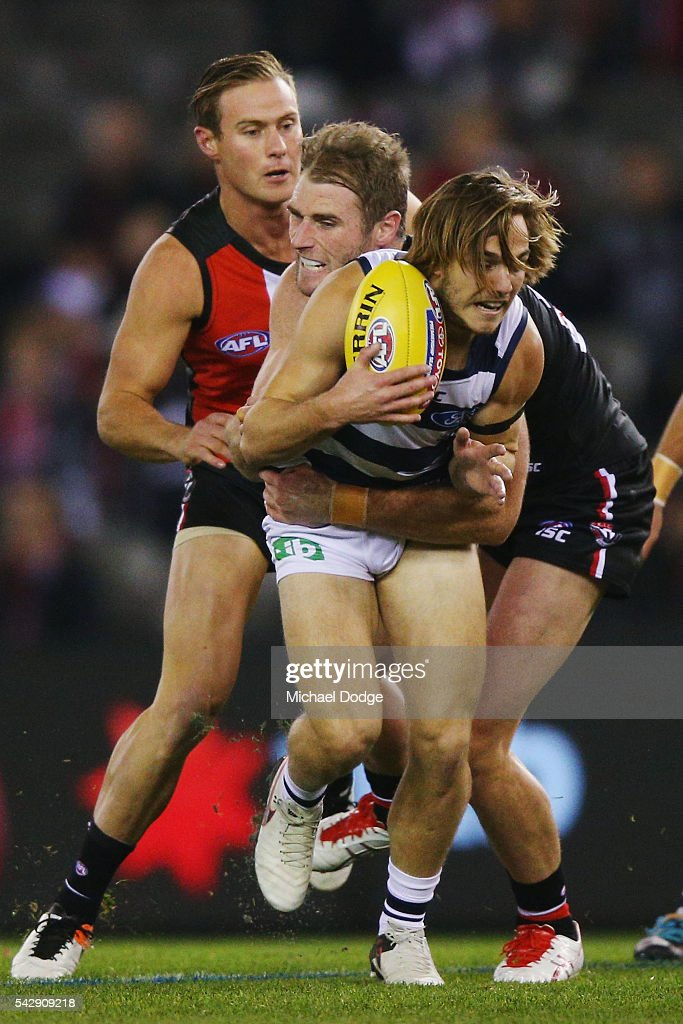 Tim Membrey of the Saints is tackled by Luke Delaney of the Saints during the round 14 AFL match between the St Kilda Saints and the Geelong Cats at Etihad Stadium on June 25, 2016 in Melbourne, Australia.
