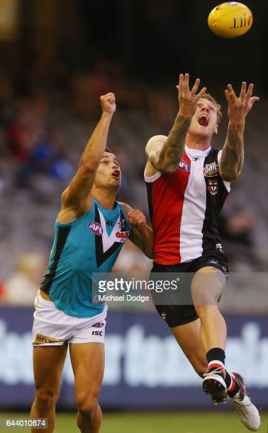 Tim Membrey of the Saints marks the ball against Jarman Impey of the Power during the JLT Community Series AFL match between the St Kilda Saints and...