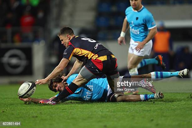 Tim Menzel of Germany is challenged by Mateo Sanguinetti of Uruguay during an international match between Germany and Uruguay at Frankfurter...