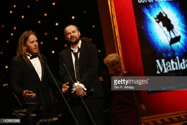 Tim Minchin and Dennis Kelly accept the award for Best Musical for 'Matilda The Musical' at the 2012 Olivier Awards at The Royal Opera House on April...