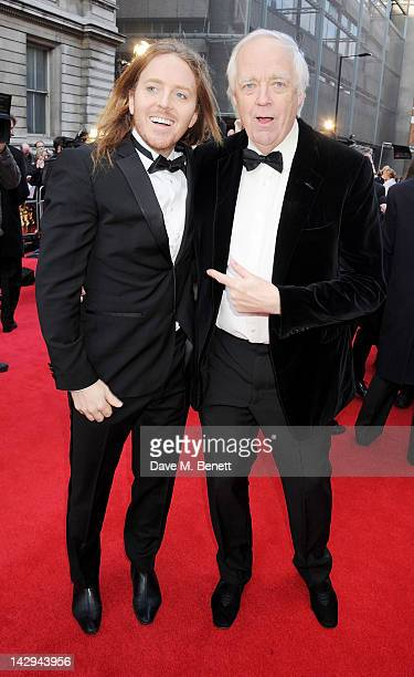 Tim Minchin and Sir Tim Rice arrive at the 2012 Olivier Awards held at The Royal Opera House on April 15 2012 in London England