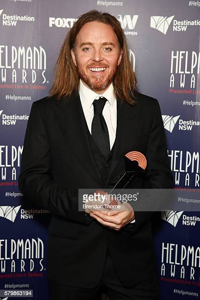 Tim Minchin poses with the award for Best Original Score in Matilda the Musical in the awards room at 16th Annual Helpmann Awards at Lyric Theatre...