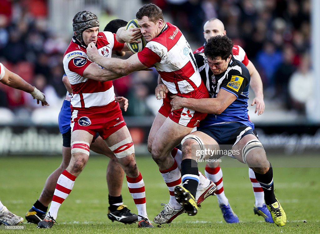 Tim Molenaar of Gloucester is tackled by <a gi-track='captionPersonalityLinkClicked' href=/galleries/search?phrase=Francois+Louw&family=editorial&specificpeople=4389467 ng-click='$event.stopPropagation()'>Francois Louw</a> of Bath during the LV= Cup match between Gloucester and Bath at the Kingsholm Stadium on February 2, 2013 in Gloucester, England.