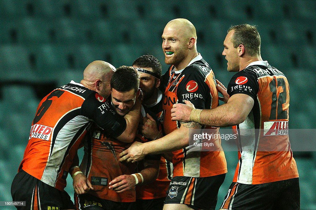 Tim Moltzen (2nd L) of the Tigers celebrates with team mates after scoring a try during the round 23 NRL match between the Wests Tigers and the St George Illawarra Dragons at Allianz Stadium on August 11, 2012 in Sydney, Australia.