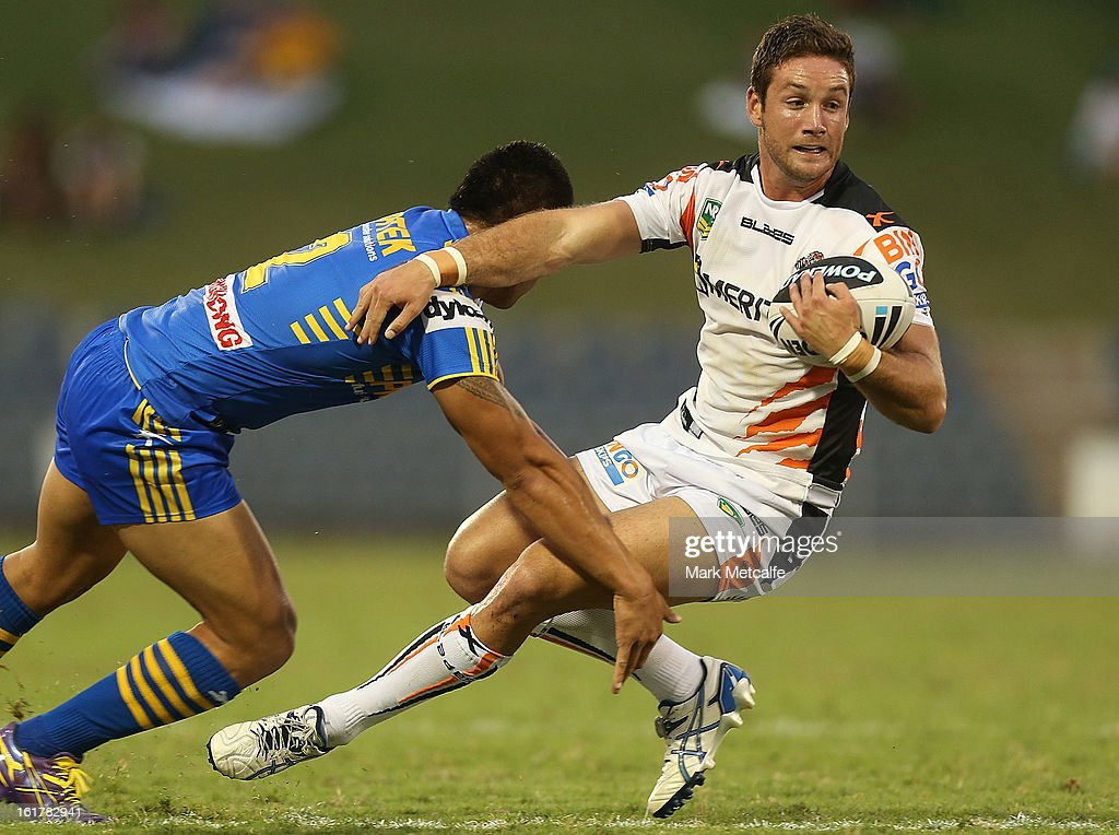 Tim Moltzen of the Tigers is tackled during the NRL trial match between the Wests Tigers and the Parramatta Eels at Campbelltown Sports Stadium on February 16, 2013 in Sydney, Australia.