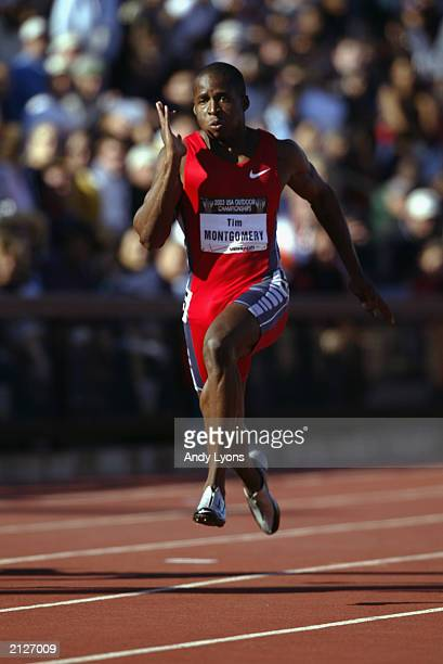 Tim Montgomery competes in the men's 100m semifinals prelims at the USA Outdoor Track and Field Championships on June 20 2003 at Cobb Track and...