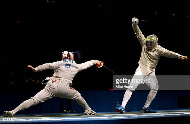 Tim Morehouse of the United States and Tamas Decsi of Hungary compete in the men's team sabre fencing quarterfinals at the Fencing Hall of National...