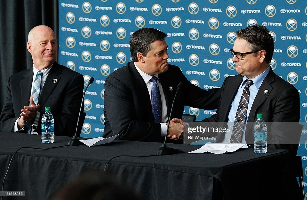 Tim Murray (R) is introduced as the new general manager of the Buffalo Sabres on January 9, 2014 at the First Niagara Center in Buffalo, New York. With him are Craig Patrick (L), named special assistant and advisor to the hockey department and team president of hockey operations Pat LaFontaine (C).
