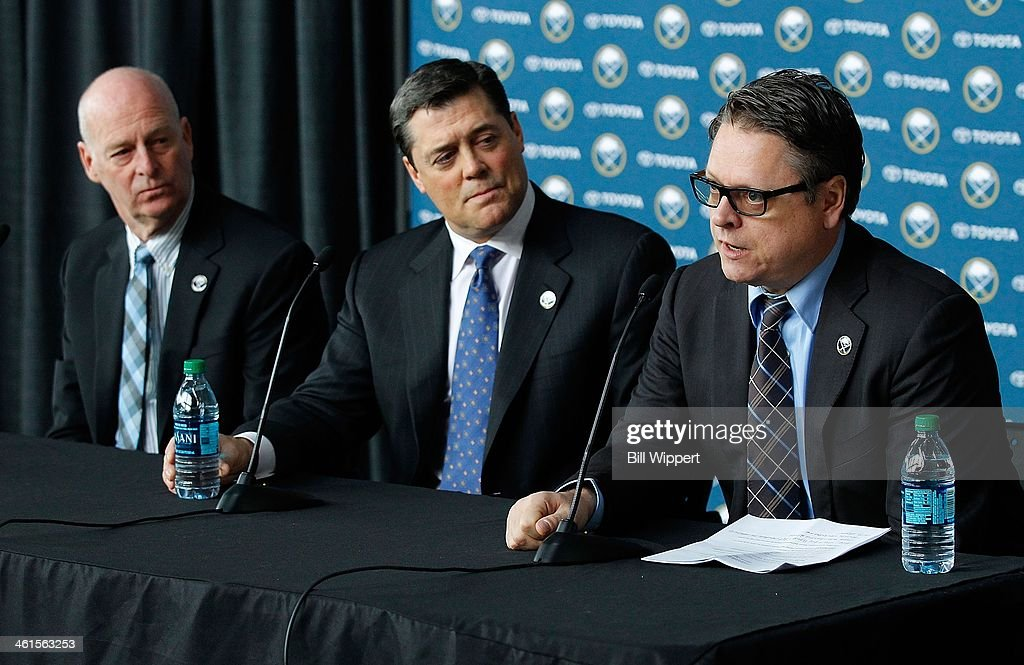 Tim Murray (R) speaks at a media conference introducing him as the new general manager of the Buffalo Sabres on January 9, 2014 at the First Niagara Center in Buffalo, New York. With him are Craig Patrick (L), named special assistant and advisor to the hockey department and team president of hockey operations <a gi-track='captionPersonalityLinkClicked' href=/galleries/search?phrase=Pat+LaFontaine&family=editorial&specificpeople=213982 ng-click='$event.stopPropagation()'>Pat LaFontaine</a> (C).