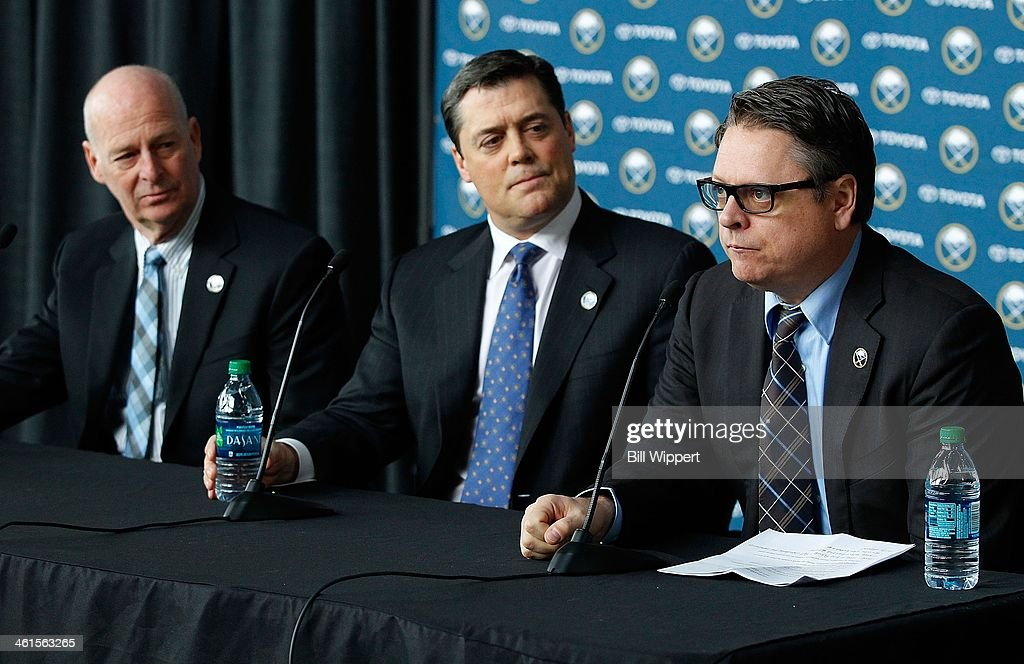 Tim Murray (R) speaks at a media conference introducing him as the new general manager of the Buffalo Sabres on January 9, 2014 at the First Niagara Center in Buffalo, New York. With him are Craig Patrick (L), named special assistant and advisor to the hockey department and team president of hockey operations Pat LaFontaine (C).